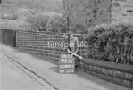 SD980191A, Man marking Ordnance Survey minor control revision point with an arrow in 1950s