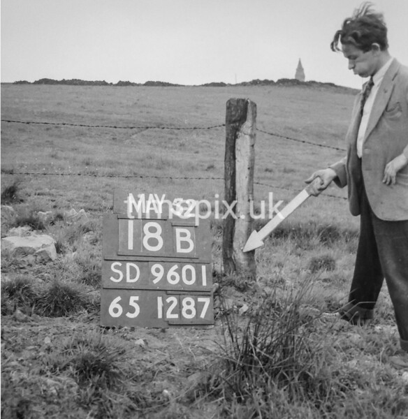 SD960118B, Man marking Ordnance Survey minor control revision point with an arrow in 1950s