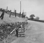 SD960069B, Man marking Ordnance Survey minor control revision point with an arrow in 1950s