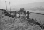 SD980177B, Man marking Ordnance Survey minor control revision point with an arrow in 1950s