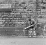 SD970144B, Man marking Ordnance Survey minor control revision point with an arrow in 1950s