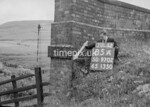 SD970285A, Man marking Ordnance Survey minor control revision point with an arrow in 1950s