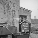 SD960270A, Man marking Ordnance Survey minor control revision point with an arrow in 1950s