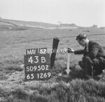 SD950243B, Man marking Ordnance Survey minor control revision point with an arrow in 1950s