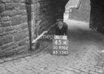 SD970245A, Man marking Ordnance Survey minor control revision point with an arrow in 1950s