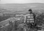 SD980184B, Man marking Ordnance Survey minor control revision point with an arrow in 1950s