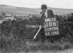 SD970010B, Man marking Ordnance Survey minor control revision point with an arrow in 1950s