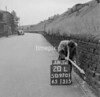 SD970120L, Man marking Ordnance Survey minor control revision point with an arrow in 1950s