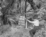 SD960105A, Man marking Ordnance Survey minor control revision point with an arrow in 1950s