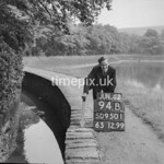 SD950194B, Man marking Ordnance Survey minor control revision point with an arrow in 1950s