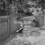 SD960284L, Man marking Ordnance Survey minor control revision point with an arrow in 1950s