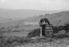 SD980280B, Man marking Ordnance Survey minor control revision point with an arrow in 1950s