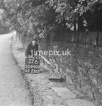 SD960037B, Man marking Ordnance Survey minor control revision point with an arrow in 1950s