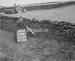 SD960056A1, Man marking Ordnance Survey minor control revision point with an arrow in 1950s