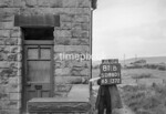 SD980181B, Man marking Ordnance Survey minor control revision point with an arrow in 1950s