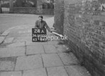 SD950024A, Man marking Ordnance Survey minor control revision point with an arrow in 1950s