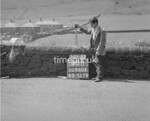 SD960288B, Man marking Ordnance Survey minor control revision point with an arrow in 1950s