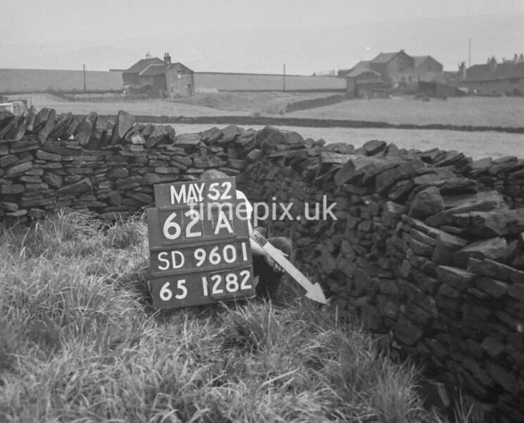 SD960162A, Man marking Ordnance Survey minor control revision point with an arrow in 1950s