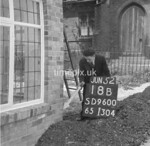 SD960018B, Man marking Ordnance Survey minor control revision point with an arrow in 1950s