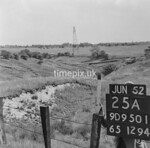 SD950125A, Man marking Ordnance Survey minor control revision point with an arrow in 1950s