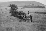 SD980214A, Man marking Ordnance Survey minor control revision point with an arrow in 1950s