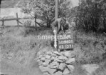 SD980181A, Man marking Ordnance Survey minor control revision point with an arrow in 1950s