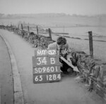 SD960134B, Man marking Ordnance Survey minor control revision point with an arrow in 1950s
