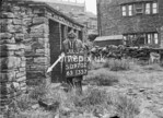 SD970279B, Man marking Ordnance Survey minor control revision point with an arrow in 1950s