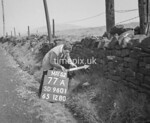 SD960177A, Man marking Ordnance Survey minor control revision point with an arrow in 1950s