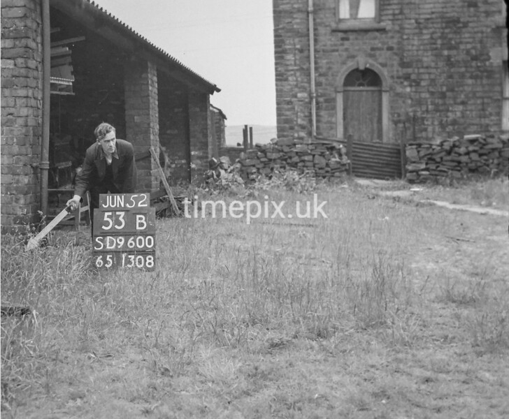 SD960053B1, Man marking Ordnance Survey minor control revision point with an arrow in 1950s