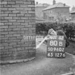 SD960280B, Man marking Ordnance Survey minor control revision point with an arrow in 1950s