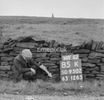 SD950285K, Man marking Ordnance Survey minor control revision point with an arrow in 1950s