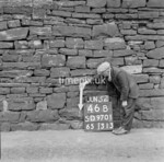 SD970146B, Man marking Ordnance Survey minor control revision point with an arrow in 1950s