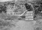 SD970221B, Man marking Ordnance Survey minor control revision point with an arrow in 1950s