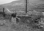 SD970134A, Man marking Ordnance Survey minor control revision point with an arrow in 1950s