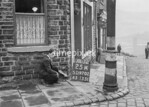 SD970225A, Man marking Ordnance Survey minor control revision point with an arrow in 1950s