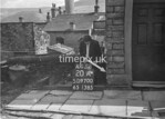 SD970020A, Man marking Ordnance Survey minor control revision point with an arrow in 1950s