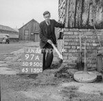 SD950097A, Man marking Ordnance Survey minor control revision point with an arrow in 1950s