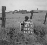 SD950167A, Man marking Ordnance Survey minor control revision point with an arrow in 1950s