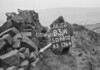 SD980283A, Man marking Ordnance Survey minor control revision point with an arrow in 1950s