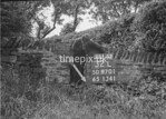 SD970132L, Man marking Ordnance Survey minor control revision point with an arrow in 1950s