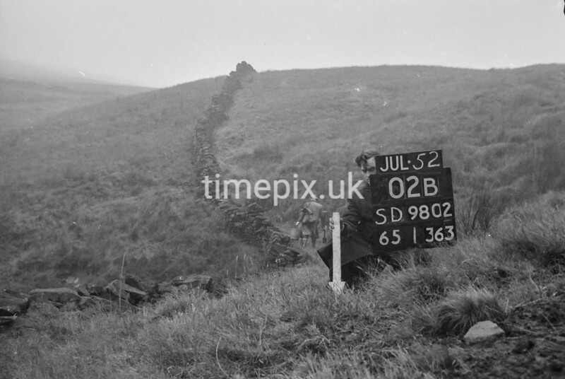 SD980202B, Man marking Ordnance Survey minor control revision point with an arrow in 1950s