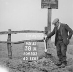 SD950238A, Man marking Ordnance Survey minor control revision point with an arrow in 1950s