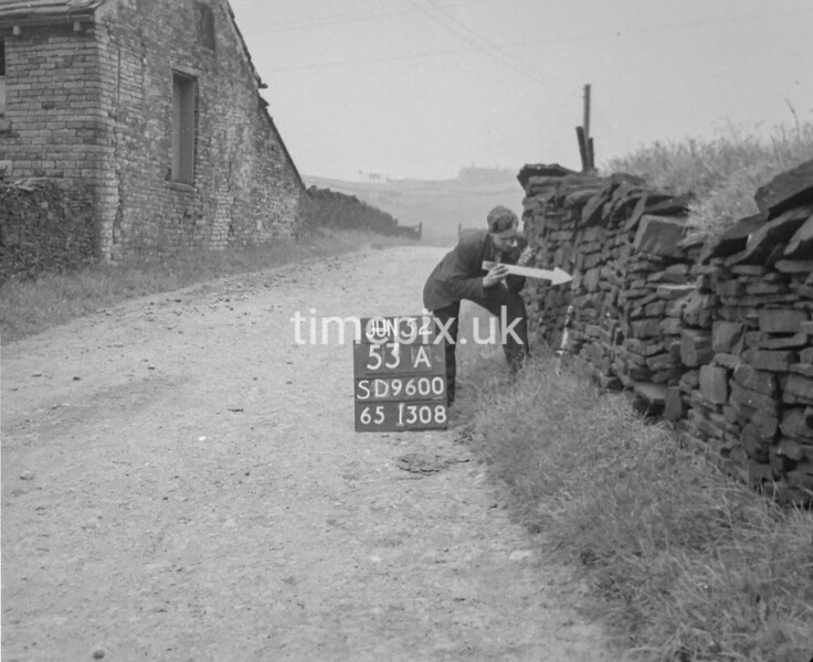 SD960053A, Man marking Ordnance Survey minor control revision point with an arrow in 1950s