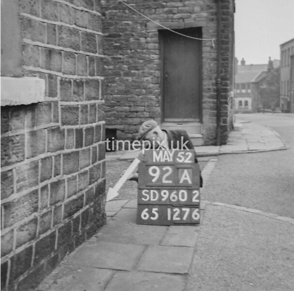 SD960292A, Man marking Ordnance Survey minor control revision point with an arrow in 1950s