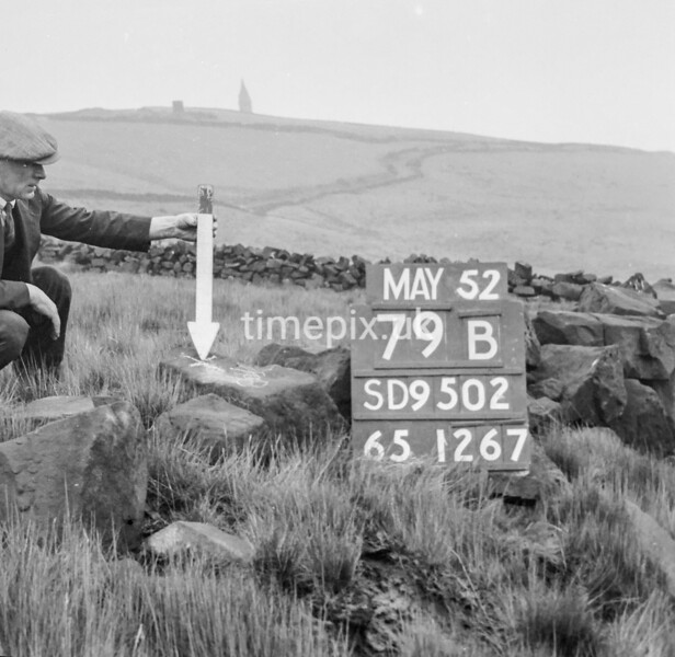 SD950279B, Man marking Ordnance Survey minor control revision point with an arrow in 1950s