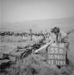 SD960155B, Man marking Ordnance Survey minor control revision point with an arrow in 1950s