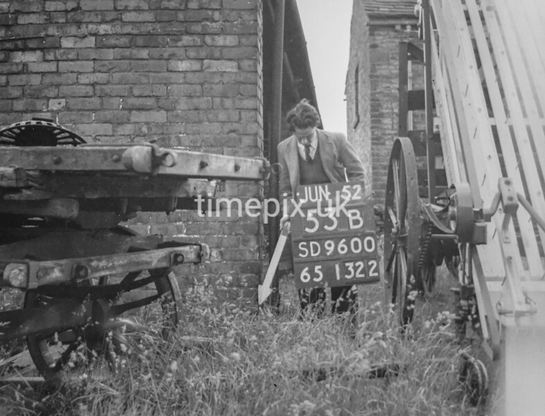 SD960053B2, Man marking Ordnance Survey minor control revision point with an arrow in 1950s