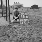 SD950058B, Man marking Ordnance Survey minor control revision point with an arrow in 1950s