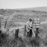 SD960118A, Man marking Ordnance Survey minor control revision point with an arrow in 1950s